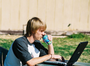 young male student working at a laptop